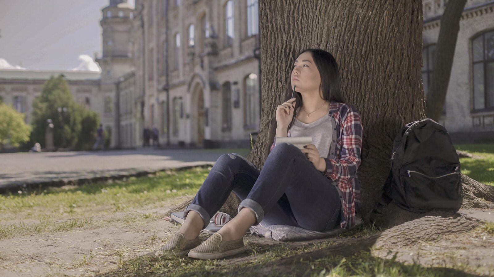 Women sat under tree